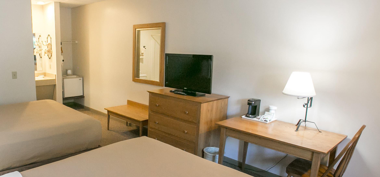Room amenities including Refrigerator, TV, Coffee Maker, etc.