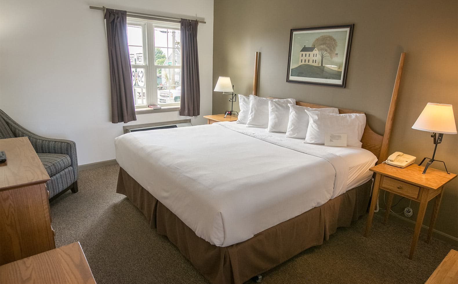 King bed with pillows in ADA Room